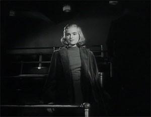 Flickan från tredje raden filmruta